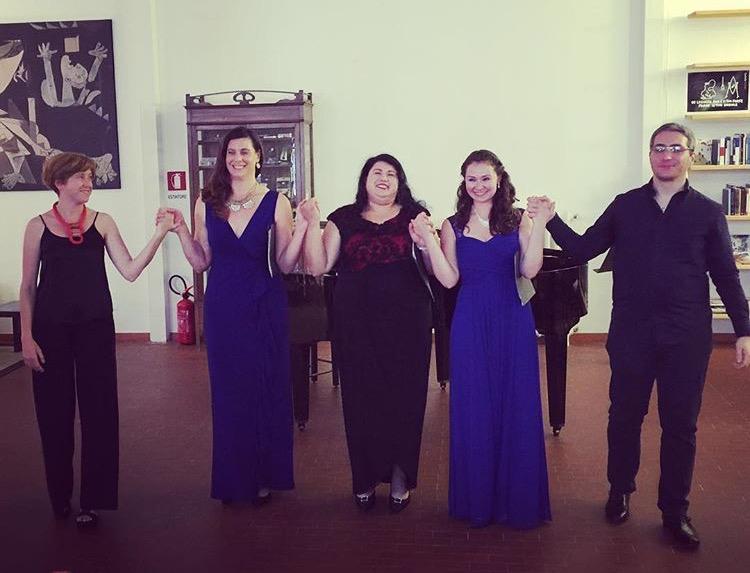 A post-concert smile in Milan, Italy, with mezzo-soprano Jennie Legary, soprano Anastasia Rege, accompanist Maria Silvana Pavan, and guitarist Emilio Elli