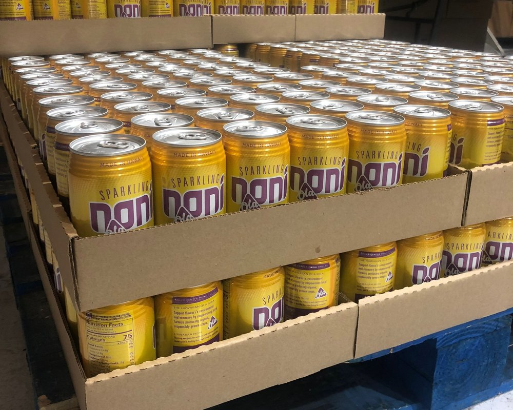 Our beautiful new Sparkling Noni cans!