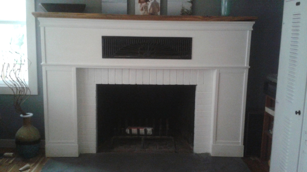 The same fireplace got a new live edge cedar mantel, a craftsman surround, a poured concrete hearth, and kept the original (1930s) grill. That's a classic look.