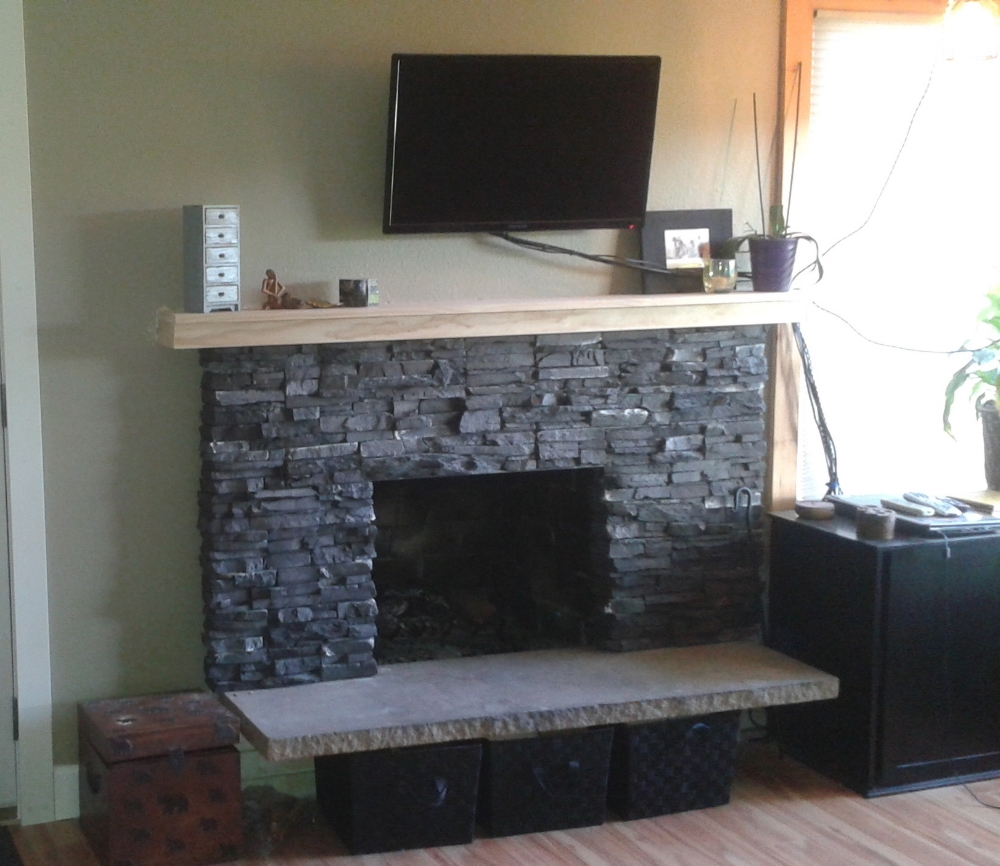This northwest inspired stacked stone surround and bulked up mantel makes a cozy living room you want to share with guests.