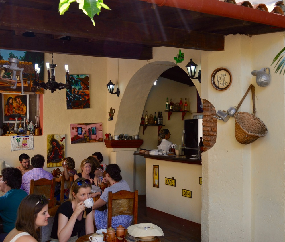 You'll find lots of old cafeteras (Cuban coffee pots) hanging on the walls at Cafe Don Pepe.