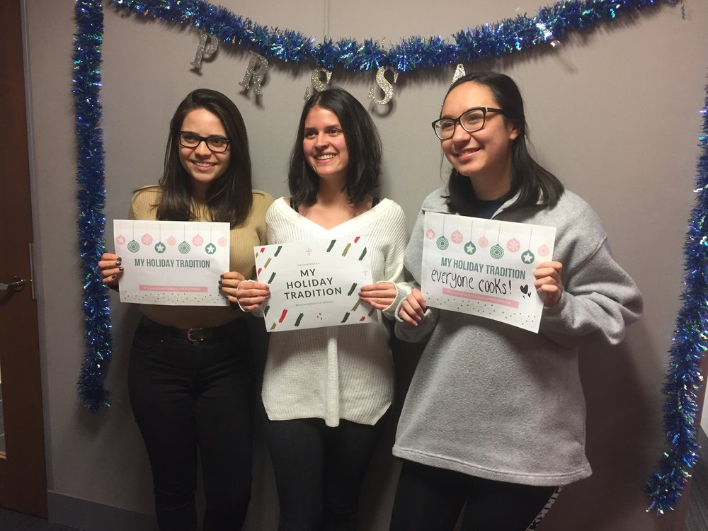 UF PRSSA members Celeste Mahfood, Valentina Pinzon and Christine Skofronick participating in the #FosteringFamilyTraditions campaign at our holiday social event