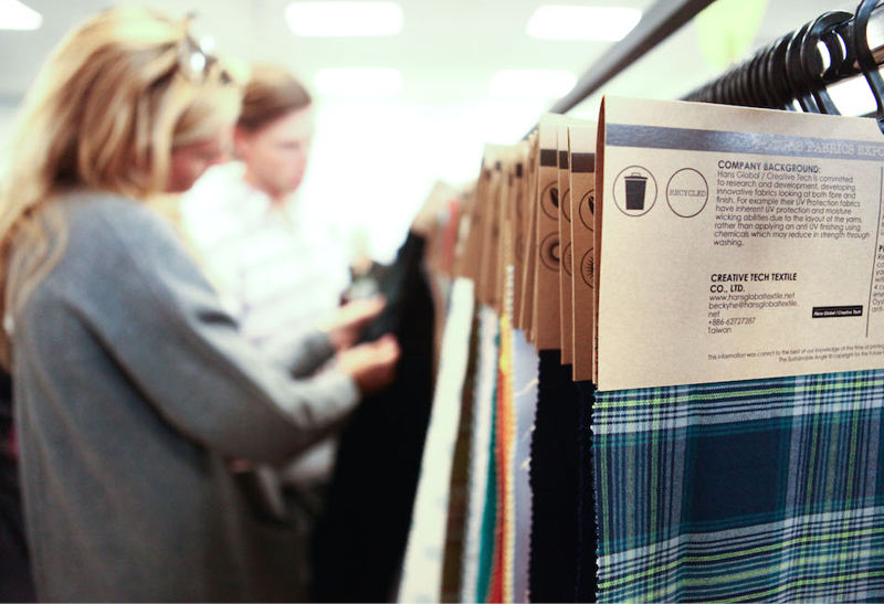 Fabrics display at the  Future Fabrics Expo, London 2015:  Information on fabric mills and the environmental and social impact is provided for each of the textiles in The Sustainable Angle's library.