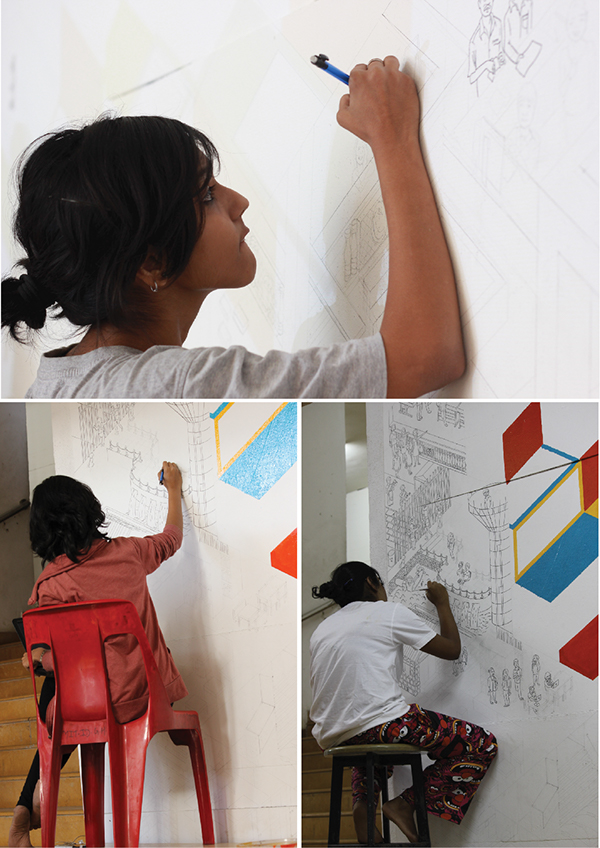 The process of drawing the people directly on the wall and inking the details of each location of the institute.