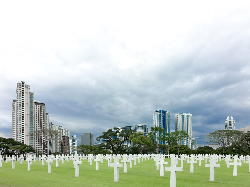 View from another reading spot. These buildings at BGC act as backdrop for these tombstones.