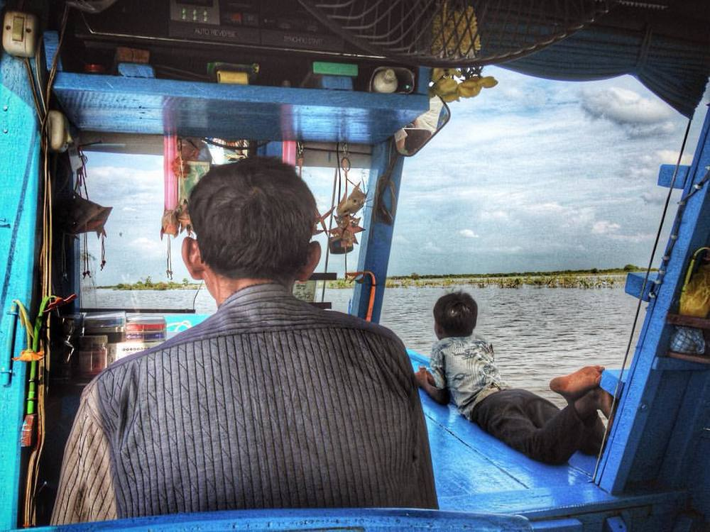 Father and son on Tonle Sap Lake