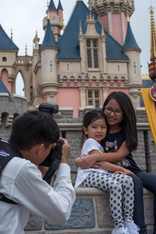 Tip: Since selfie sticks aren't allowed inside the park, have the resident photographer take a photo of your family with his camera (which you can buy at one of the shops). Then ask him to take another picture with YOUR camera. That's gonna save you at least Php 700 for a copy of that one photo he took.