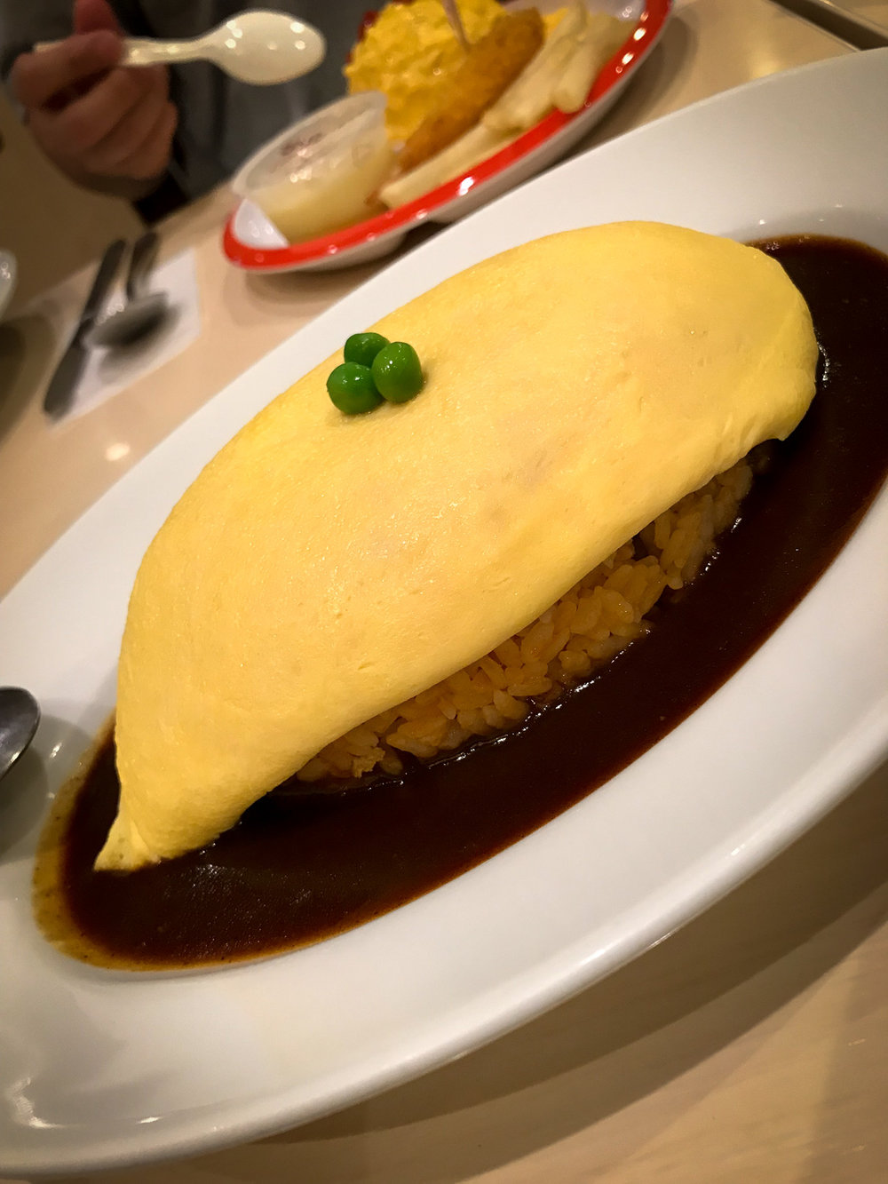 The video of me cutting up the egg of this gorgeous Omurice was a big fail. This one's a cheap but yummy dish in one of Tokyo's train stations.