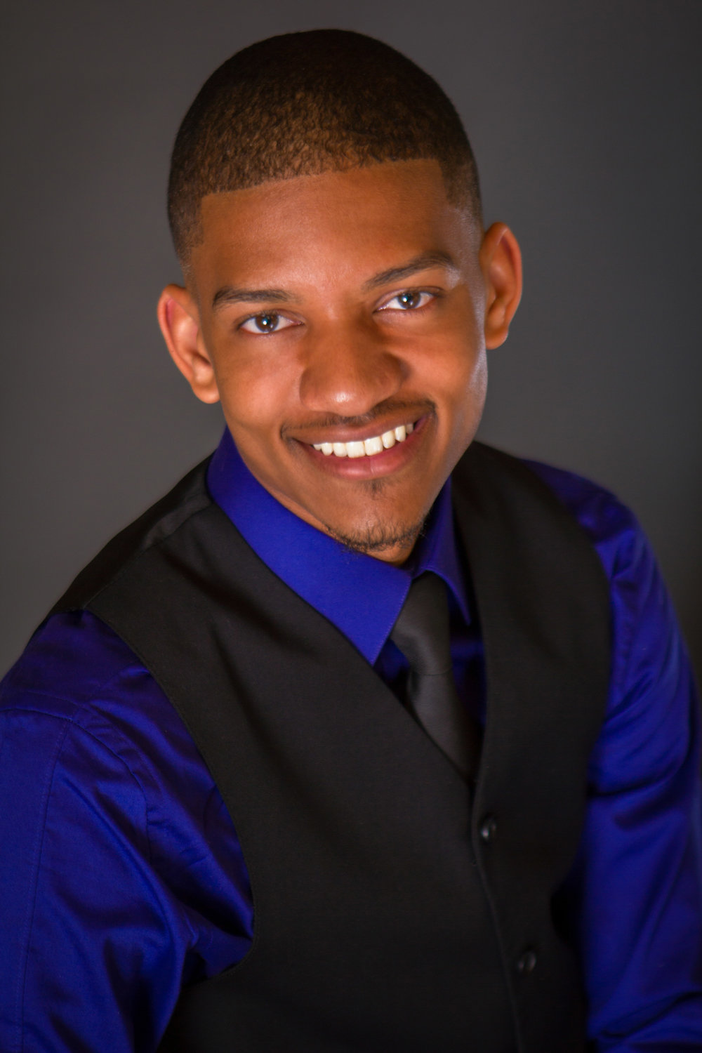 Isaiah Showell Headshot - Tell-A-Vision Films.jpg