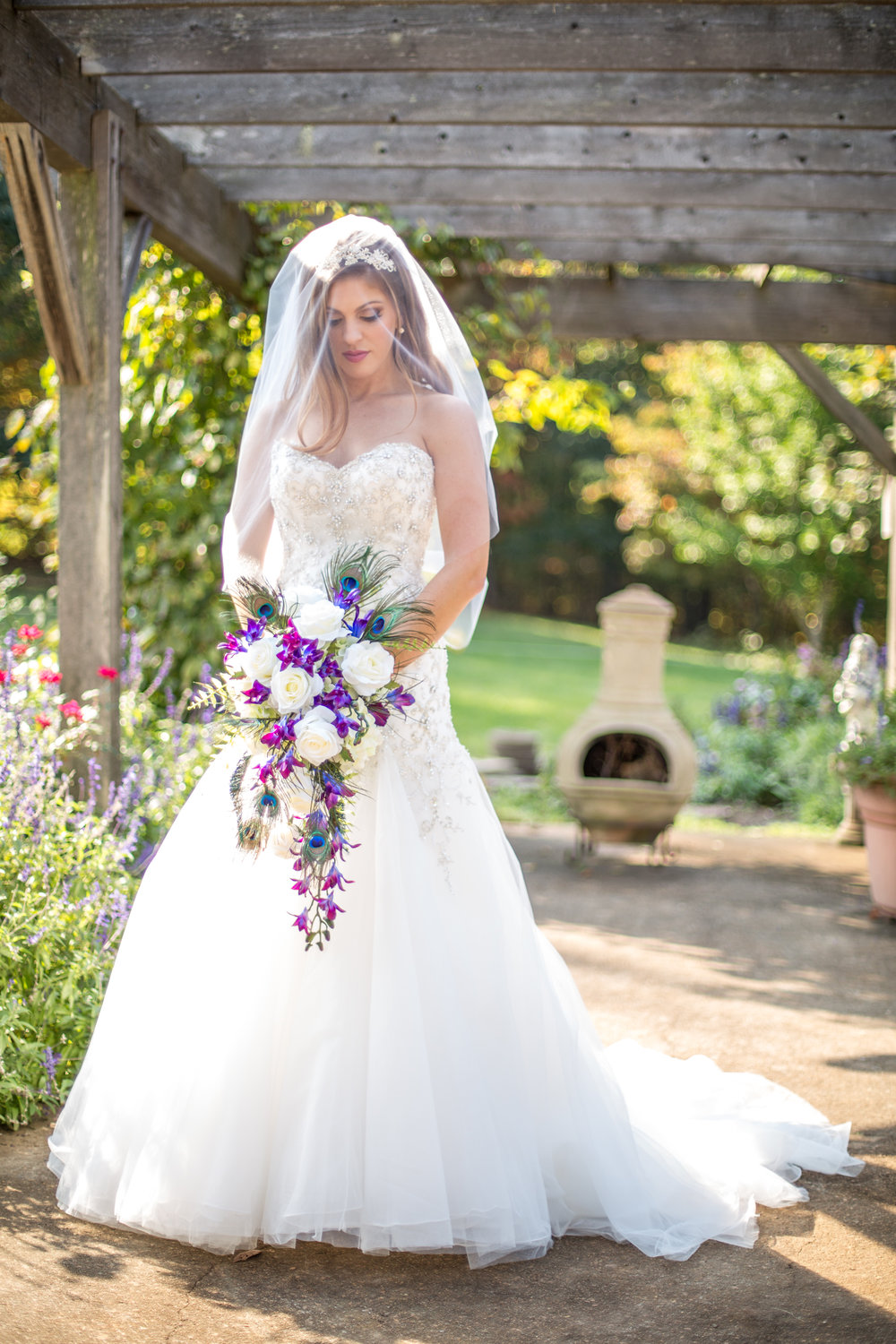 Illusions and Richard Designs - We offer a variety of veils, headpieces, combs, headbands, belts, jewelry, and shoes allowing all brides to perfect their bridal ensemble.  We carry different designers for veils including Illusions and Richard Designs.