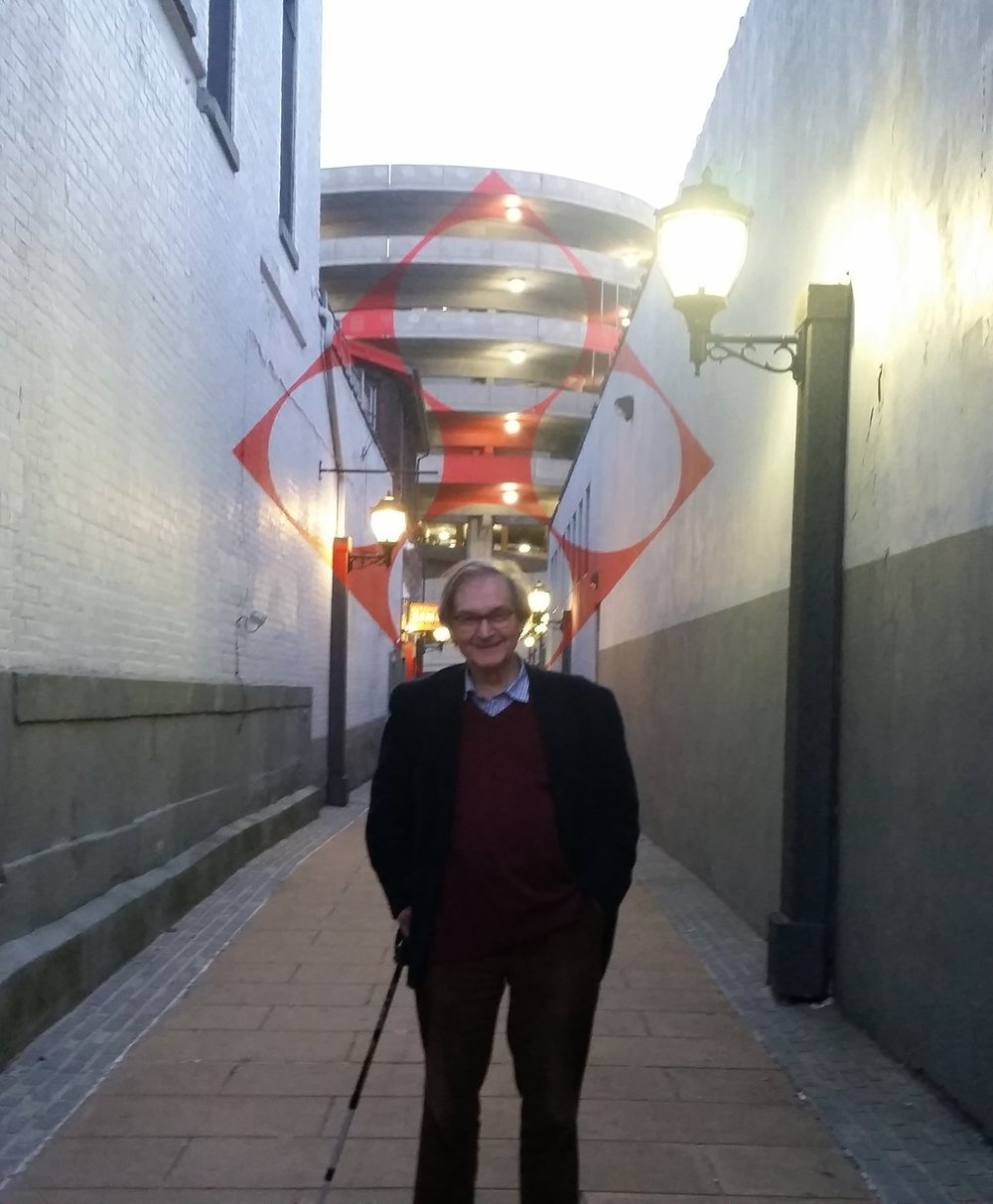 "Sir Roger Penrose standing in front of Varini's ""Square with four circles"" in New Haven. Photo by Jack Harris"