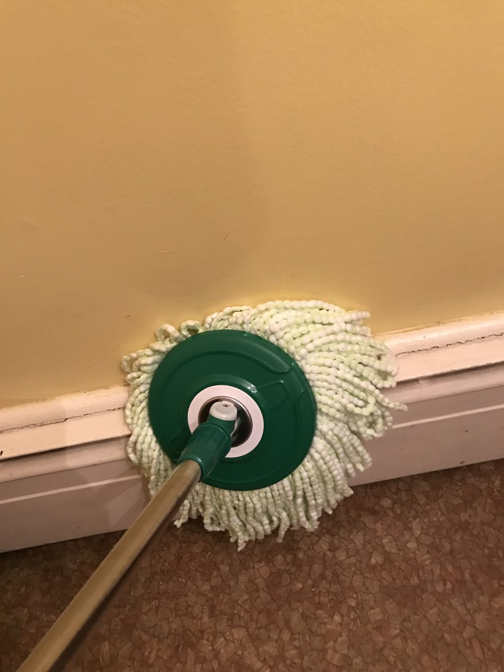 Libman spin mop wiping the dust off baseboard heaters so I don't have to bend down to do it. WIN!