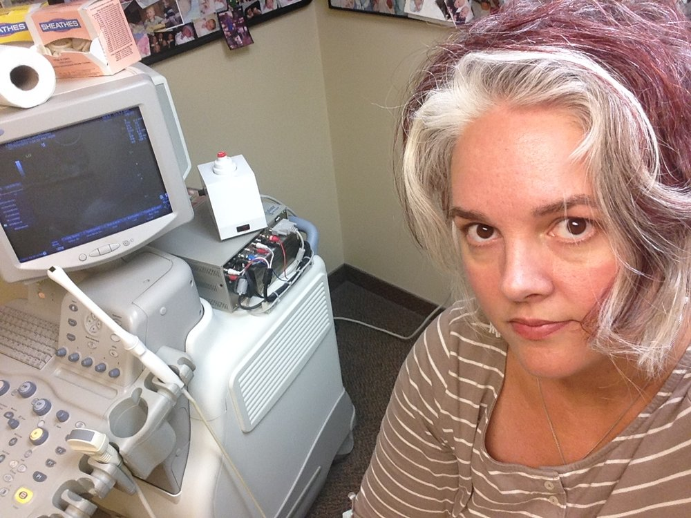 Doctor's office selfie. I was waiting for an ultrasound and preparing for an endometrial biopsy to rule out uterine cancer. (Both those showed clear and healthy results.) My stomach and esophagus not so much.