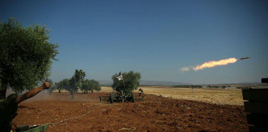 Rebels fire a Katyusha rocket at ISIS positions
