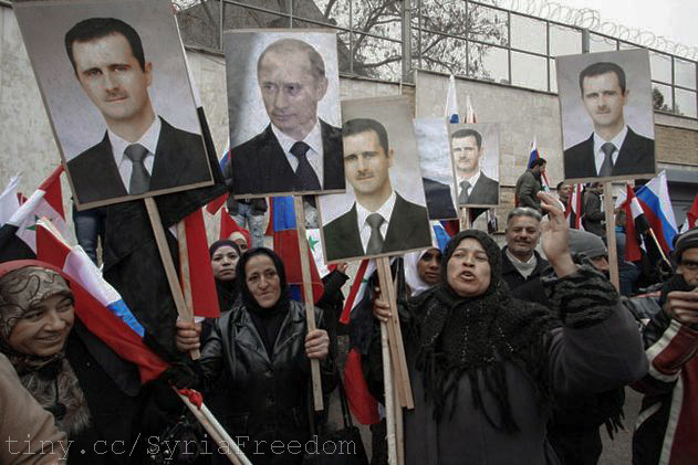 Syrians hold photos of Assad and Putin during a pro-regime protest in front of the Russian embassy in Damascus, Syria.