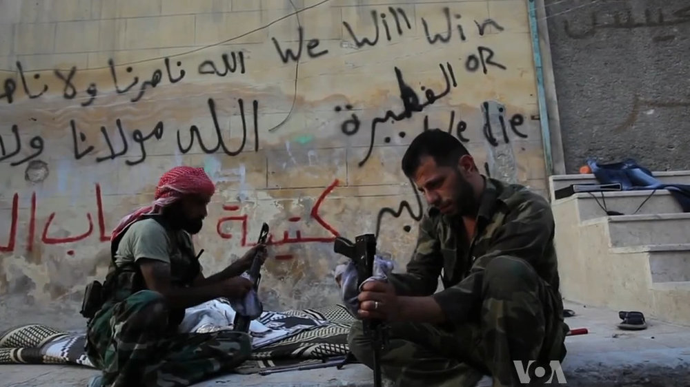 FSA_rebels_cleaning_their_AK47s.jpg