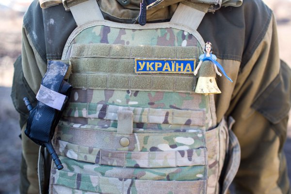 A Ukrainian soldier's bulletproof vest, adorned with a Snow White doll for good luck. Photo: Bryce Wilson (@drjft) | Mariinka, East Ukraine.