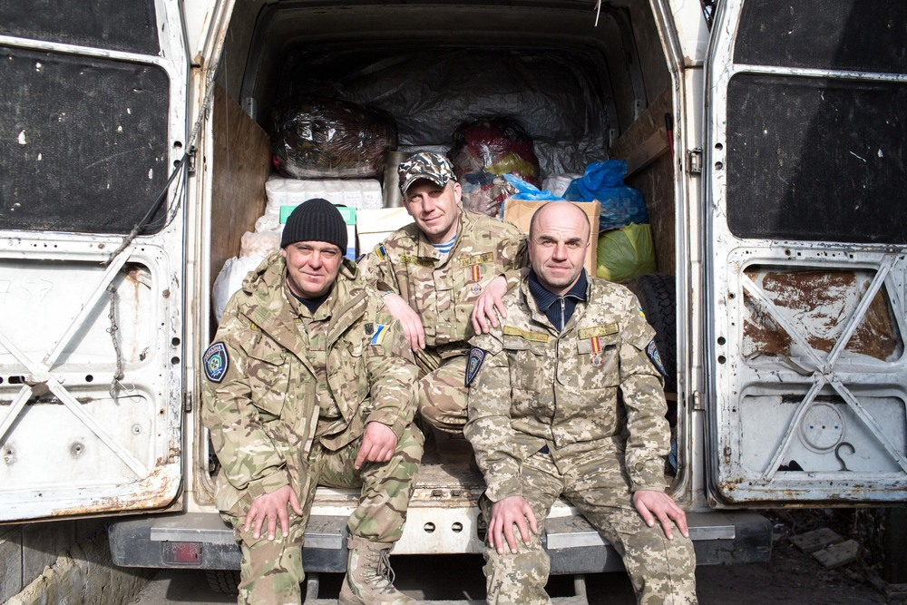 Three Ukrainian humanitarian aid suppliers. Photo courtesy of Bryce Wilson.