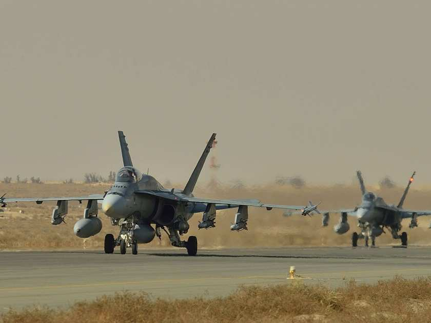 Royal Canadian Air Force CF-18 fighter jets taxi on the runway in Kuwait during Operation IMPACT on November 13, 2014. Photo: Canadian Forces Combat Camera, DND
