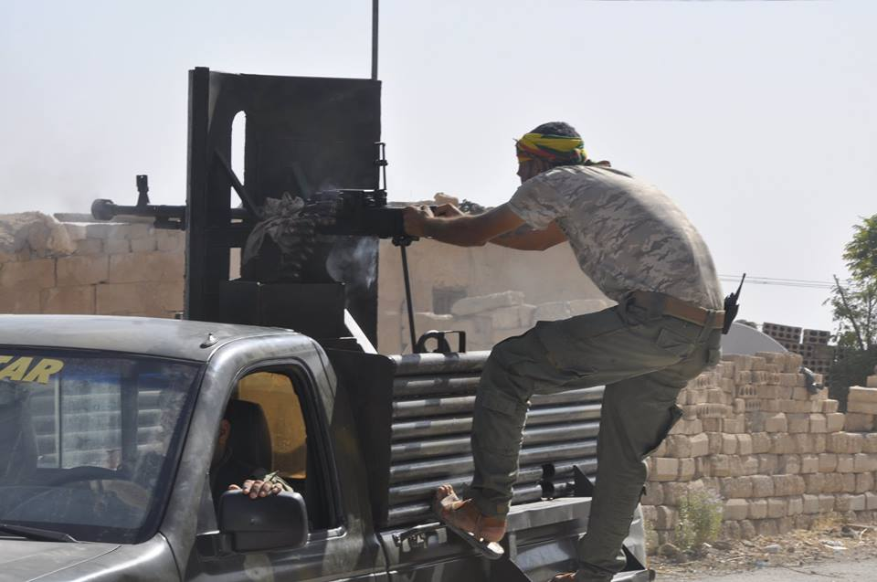 A Kurdish Asayish fighter fires on NDF in Hasakah. Image: Asayish Media.