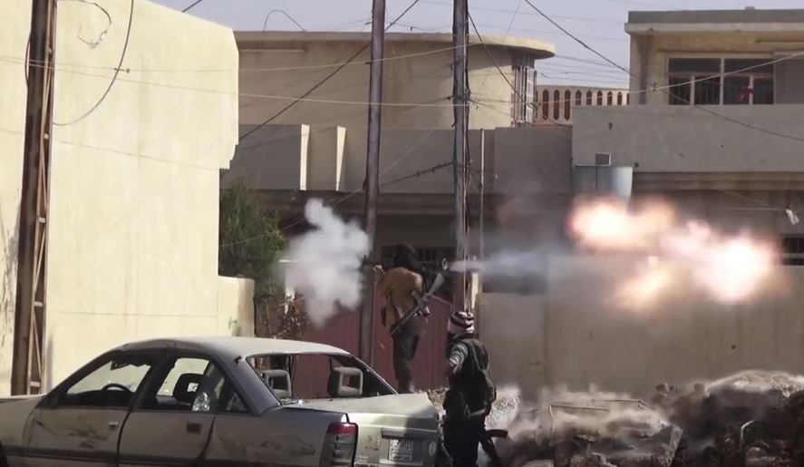 An ISIS fighter fires an RPG at Iraqi forces in Mosul.