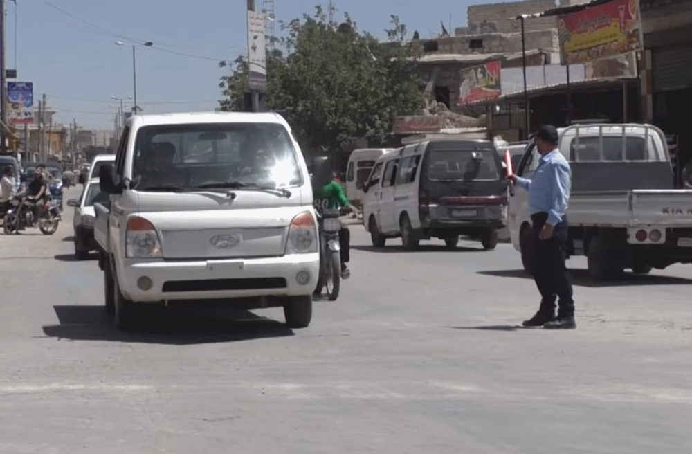 Member of the Traffic Center for Atarib town in western Aleppo regulates traffic in the town, via @SMARTNewsAgency