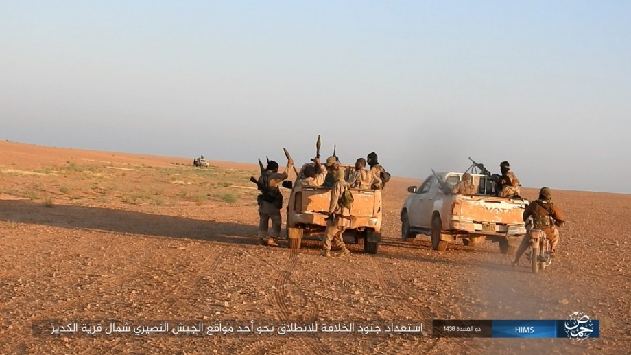 Around two dozen ISIS fighters get ready for the attack in the early morning, using motorcycles and multiple pickup trucks.