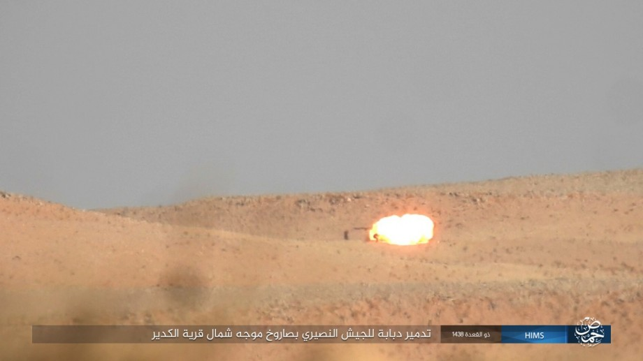A Syria government tank destroyed by an ATGM missile launch during the raid.