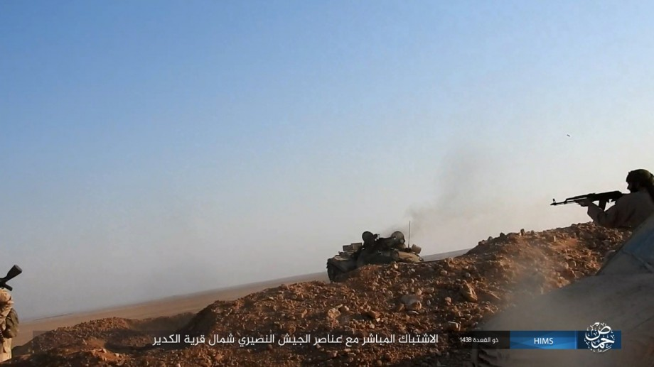 ISIS fighters overrunning the outpost an abandoned T-62 tank, later captured by ISIS