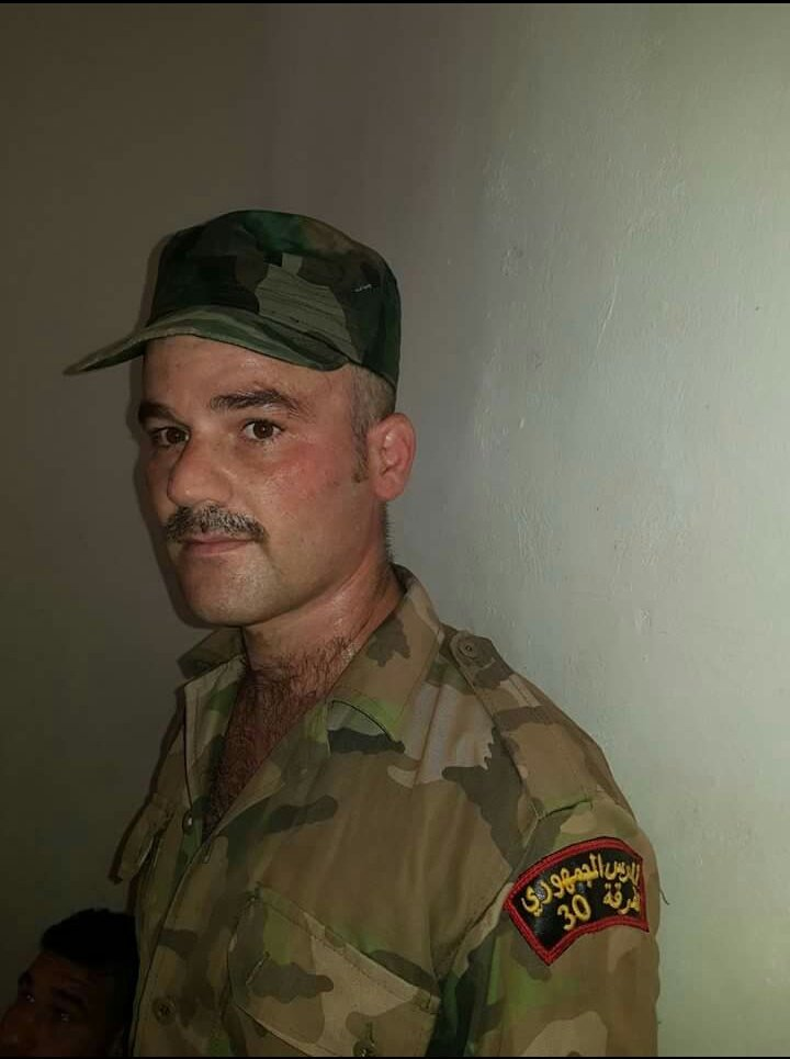 Picture of the government soldier which was arrested by Turkish-backed forces.