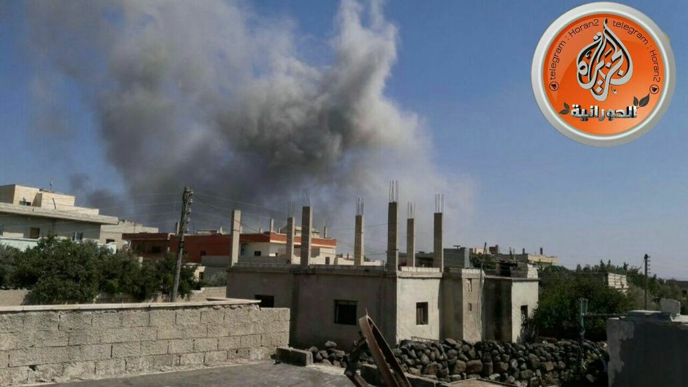 Picture shows smoke rising from the bombed position in Shajarah