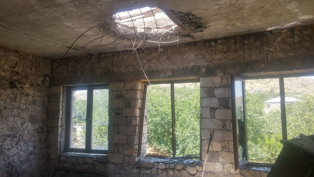 A room damaged by shelling in Talish, NKR. Image: Michael Cruickshank.