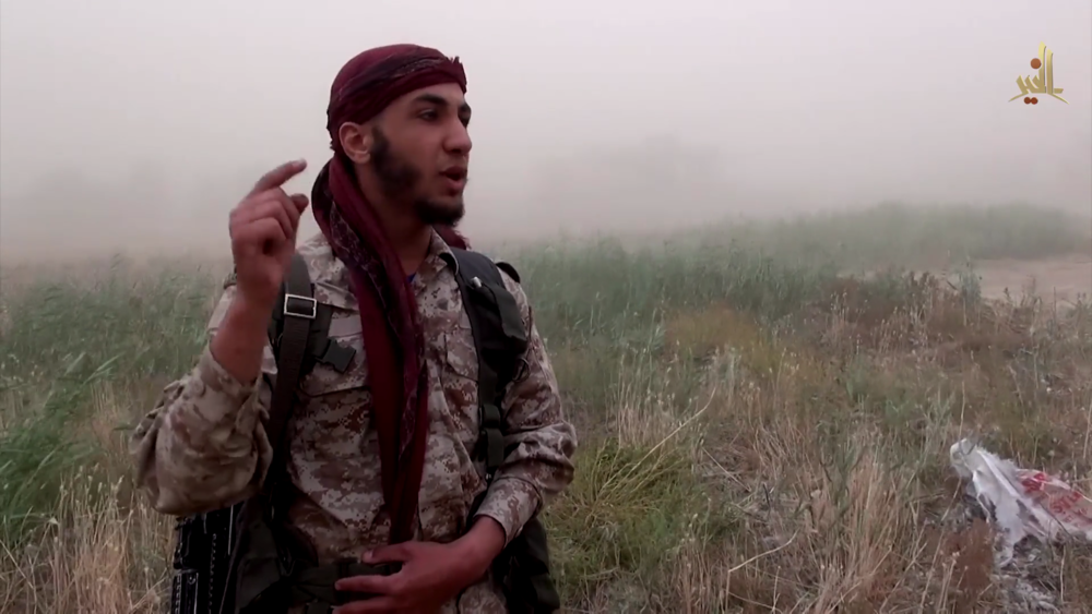 "An ISIS fighter speaks in the video, ""Sakr Island, Taken by Allah's Bounty"", released by Wilayat Khayr's media office on May 15, 2015 following the group's taking of the island."