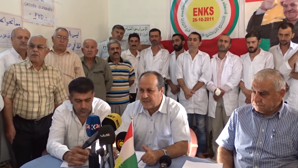 The head of the KNC's Local Councils, Mohsen Tahar, announces the end of a hunger strike protesting the PYD in September 2016.