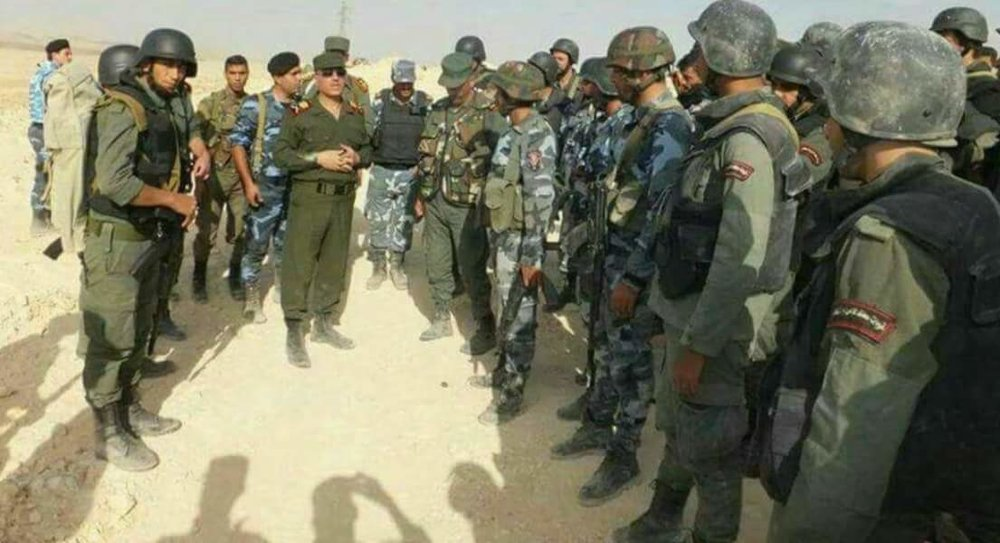 Provincial police officers from Homs, redressed in military uniform, prepare to re-take the town of Qaryatayn.