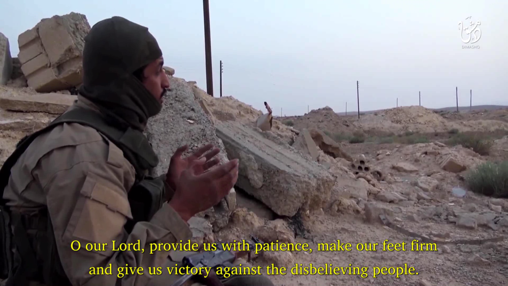 "An ISIS fighter prays during the first battle to take Qaryatayn in August 2015. Taken from the Wilayat Dimashq release, ""The Battle of Abu Hasan al-Khatha'mi - The Liberation of the City of Qaryatayn."""