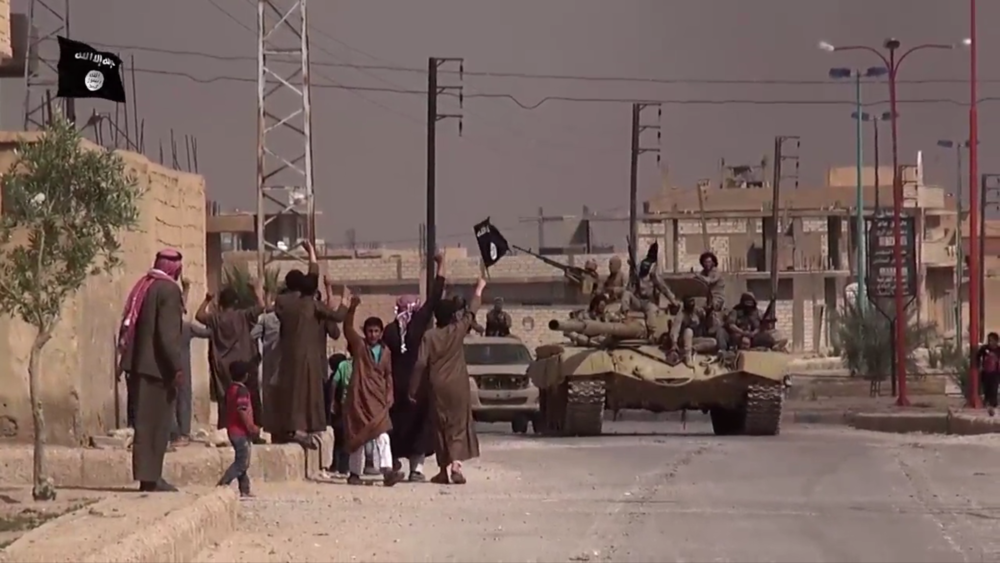 ISIS fighters march into Sukhnah after routing the Syrian military during the initial battle to capture the town in May 2015.