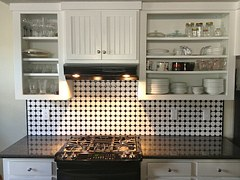 small kitchen, open shelving, wall cabinets, glass doors