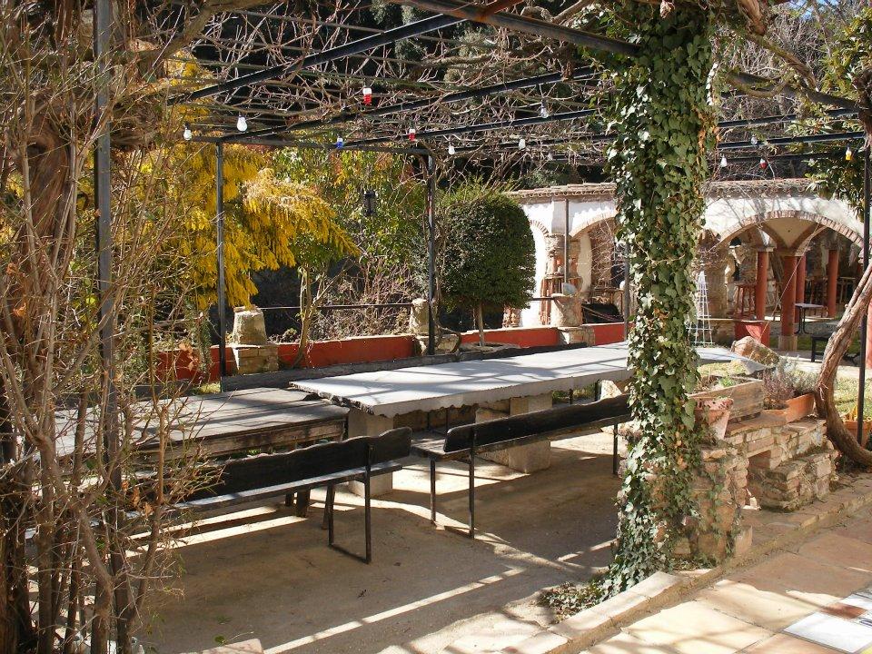 Community outdoor dining at Can Serrat