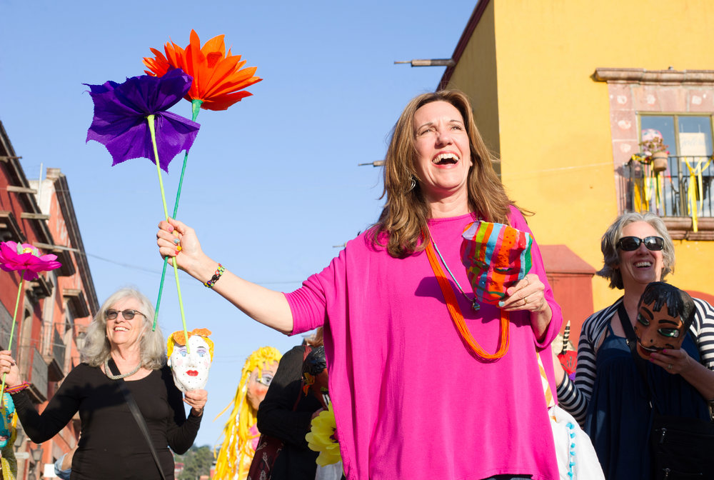 Lynn Whipple leads the parade in San Miguel, Photo by Sean Reagan