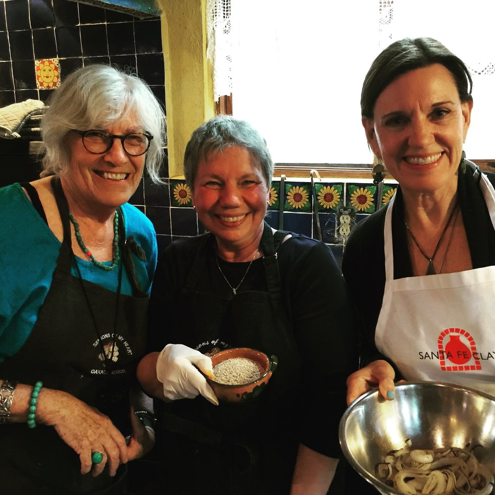 Callie, Pat and Lynn prepping for their dish at Seasons of My Heart Cooking School