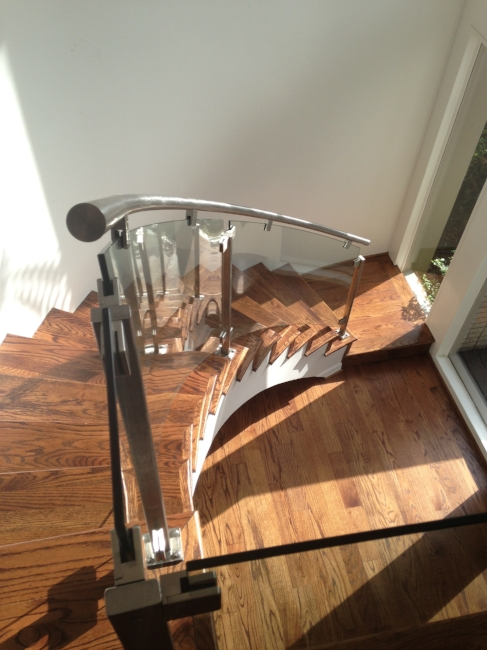 Delicieux Featuring Custom, Curved Glass With Round, Stainless Steel Handrail