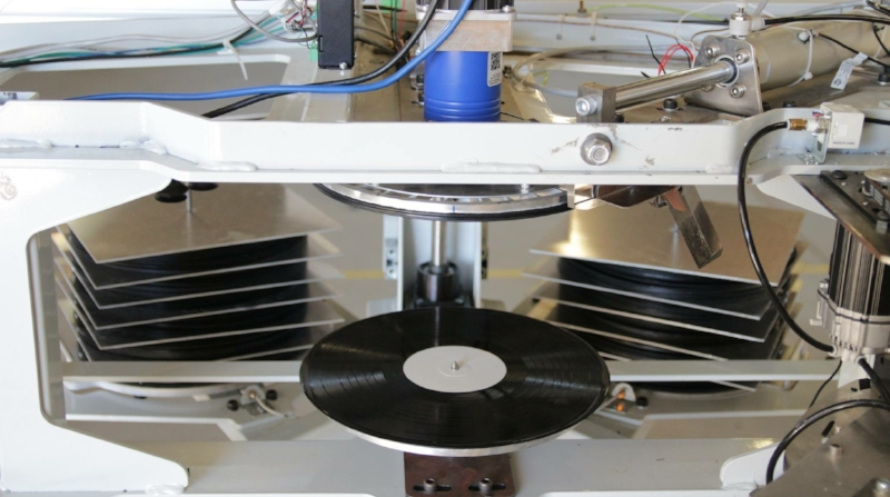 Hand Drawn Pressing uses Warm Tone Record Presses, all-new, fully automated vinyl record presses. Photo courtesy Viryl Technologies.JPG
