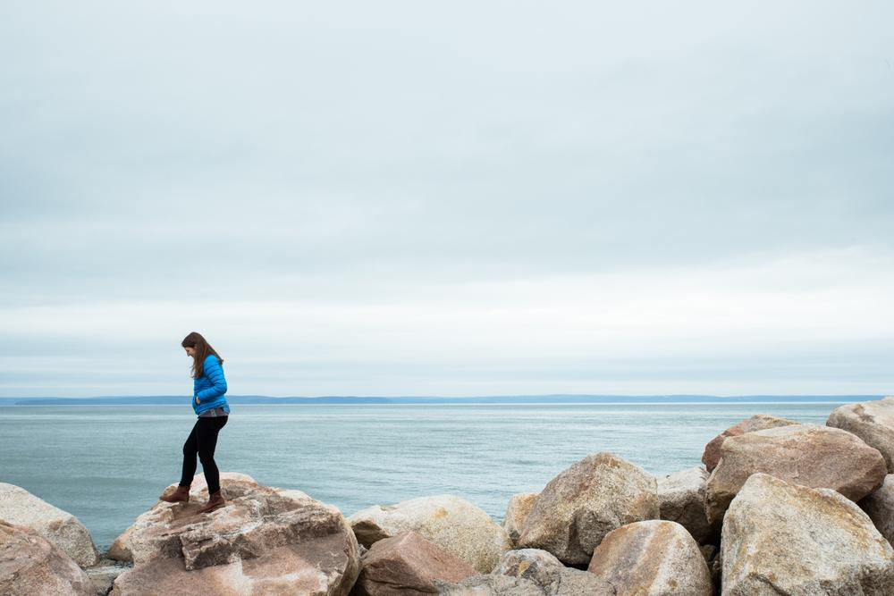 walking girl on Nova Scotia coast
