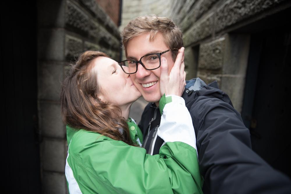 Girl kisses man in the Citadel overlooking Halifax, Nova Scotia