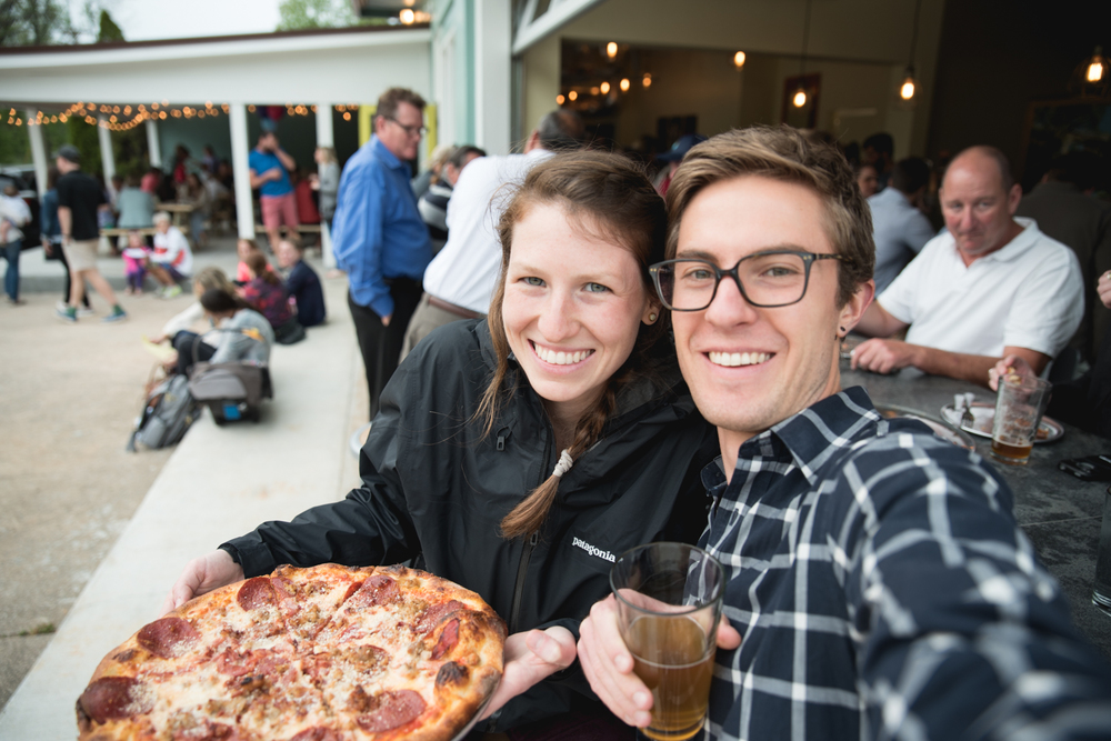 Couple eats dinner at Sidewall Pizza Co., Greenville, South Carolina