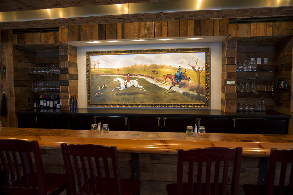 Bar    Belly up to the bar and reminisce about decades past. The oil painting was created by Metamora native  Weatherly Stroh . The piece depicts a typical composition in early equestrian art, where horses shown running had both front and back legs in motion (which isn't actually how they run!).  The wood used to build the bar was salvaged from portions of the old White Horse Inn that was demolished. The end grain bar top was crafted by carpenter John Creek, of Dryden, Michigan.