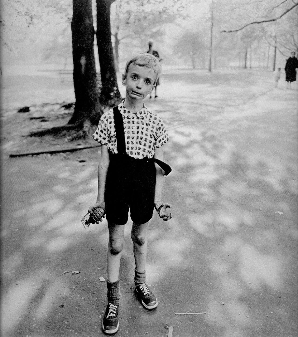"""Child with Toy Hand Grenade in Central Park, N.Y.C. 1962"", by Diane Arbus; Metropolitan Museum of Art Collection; copyrighted by the Estate of Diane Arbus"