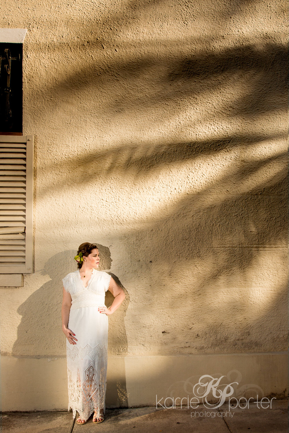 bride-posing-against-wall-with-palm-tree-shadow-during-key-west-wedding-by-photographer-karrie-porter.jpg