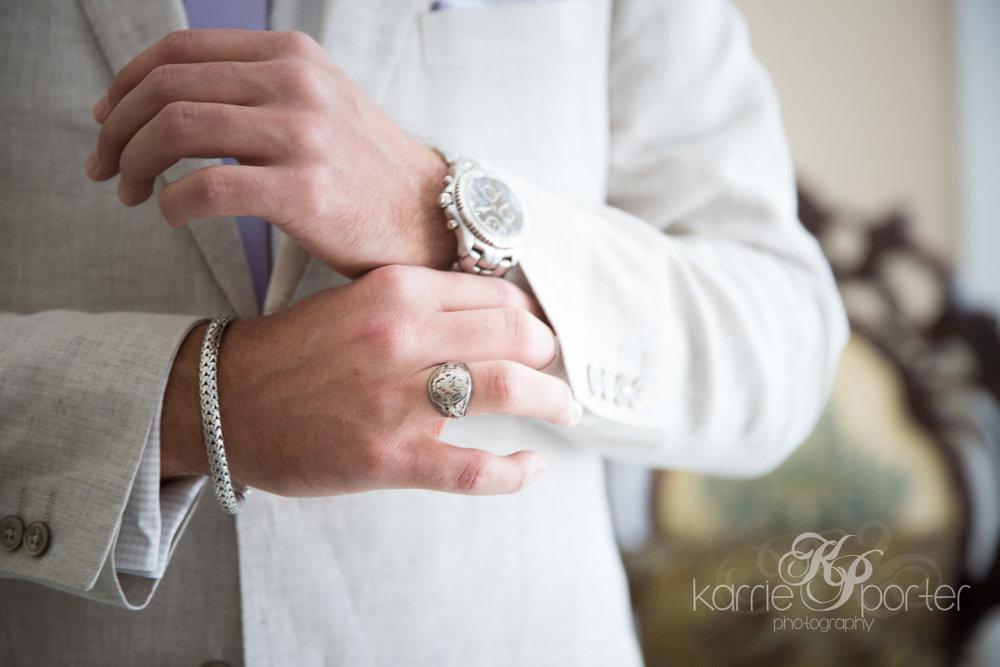 groom-adjusting-his-watch-on-wedding-day.jpg